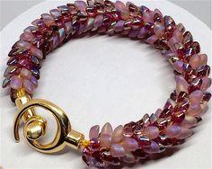 Hey, I found this really awesome Etsy listing at https://www.etsy.com/uk/listing/288367307/bracelet-pink-magatama-kumihimo-size-6