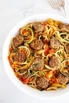 Sausage and Peppers with Zucchini Noodles Zoodle Recipes, Spiralizer Recipes, Pork Recipes, Cooking Recipes, Pasta Recipes, Dinner Entrees, Dinner Dishes, Dinner Recipes, Dinner Table