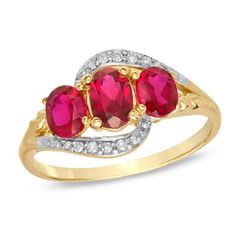 Oval Lab-Created Ruby and Diamond Three Stone Ring