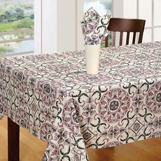 Buy Grand Delight table cover online that suits your style with its elegant look. This cover has a floral print design with combination of pink, beige and black.