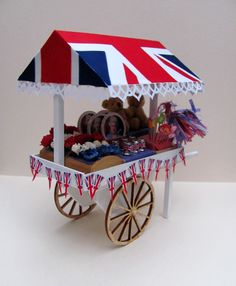 Jubilee table and souvenir cart as featured in the June 2012 issue of Dolls House and Miniature Scene magazine. This issue can be downloaded as a digital issue. For further information visit http://www.collectors-club-of-great-britain.co.uk/Information/DHMS-APPS