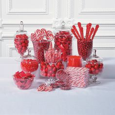 Red Candy Buffet for Christmas ... Wow your guests with a candy buffet! Includes swirl pops, chocolate candies, sugar rock candy pops, buttermints, gumballs and candy cane sticks