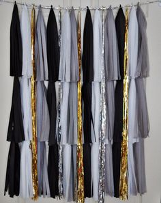This listing includes one tassel backdrop, measuring 3ft wide x 3ft long.    Colors included are grey, black, silver, white, and gold. Perfect