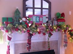 Our Christmas mantel decorated by my mom. Another masterpiece by Nina!