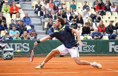 Ernests Gulbis of Latvia makes a quick run to the net for a short return against Argentinean Facundo Bagnis.