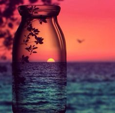 Sunset View through a Glass Bottle photography summer sunset ocean sea view bottle