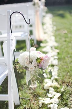 wedding aisle decor- this plus fabric draped across from each to block off the center aisle