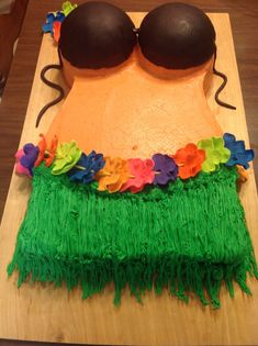 The Hawaiian Party cake I made. She wanted a coconut bra and flower lay around the grass skirt. Bra made from chocolate fondant and the flowers all made from different color fondant. Totally edible!