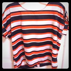 Orange, navy, and cream open back t-shirt Orange, navy, and cream stripped silky tee. Open back with button closures at top and bottom. Slightly boxy fit. Bought at Francesca's Francesca's Collections Tops Tees - Short Sleeve