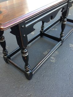 Refinished vintage bench, with three tone stain, distressed black legs, and silver wax accents.  Beautiful piece!  Enjoy it Pam!