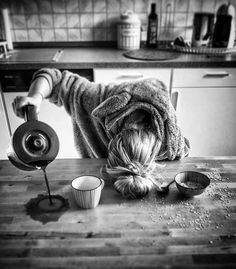 Sleeping person pours coffee onto table instead of into mug