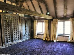 One of the rooms with ornate wooden cupboards and a purple carpet. Jane Addison, who lives nearby and walks her dogs along a track next to the property every day, remembered Flint fondly as a 'friendly' animal-lover Country Lifestyle, Country Estate, Wooden Cupboard, Red Chandelier, Purple Carpet, Wooden Gates, Log Burner, Horse Pictures, Stone Flooring