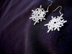 Snowflake Earrings, A small simple snowflake to grace your ears, these snowflakes are only 3 rounds to make. This pattern is available as a free Ravelry download