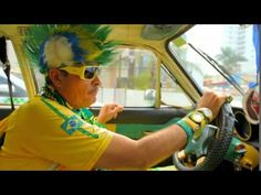 Cuiaba's own Brazilian superfan, retired police Sergeant Jose Goncalo, drives us round Cuiaba in his specially decorated car. Police Sergeant, Brazil World Cup, Portuguese