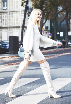 On Elena Perminova: Chloé Wool-blend Sweater Dress ($1,250) and Leather and Suede Over-the-Knee Boots ($1,544) in Mint Green and Grey.