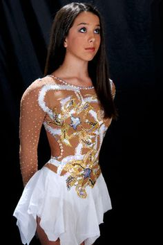 Beautiful Figure Skating Dress.  We love, love embellishing dresses with crystals. You can almost never have enough  sparkle.