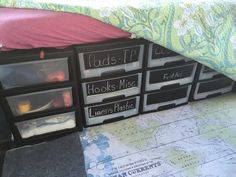Ford Transit Connect: Sterilite Drawer system supports the bed frame and gives great storage. Micro motorhome/camper.