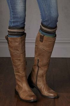 Tan leather knee boots with socks and jeans.