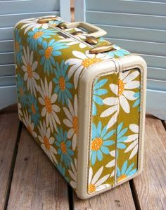 mod podge suitcase- I have a desire to use an old suitcase to display her collection of plush toys. When we need to move them to another room, easy enough..just close and carry!! This is an old suitcase with cute retro fabric mod podged on!!