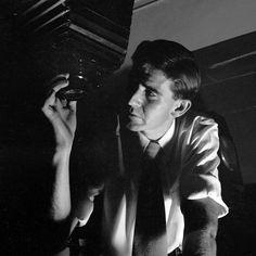 Kerry Dundas working in darkroom, c 1954.