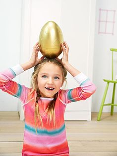 Try this alternative to the classic basket: Kids will be delighted to discover the Easter Bunny has left them an enormous gold-colored egg. To make your own, transform oversize plastic eggs (3-Piece Jumbo Nested Eggs, $20; Michaels stores) with a coat of gold spray paint and fill with holiday treats.