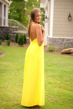 Add a splash of sunshine to your wardrobe with this yellow maxi! Fully lined with a floor-length hem, this dress features a low back design. [ Ellieclothing.com ]