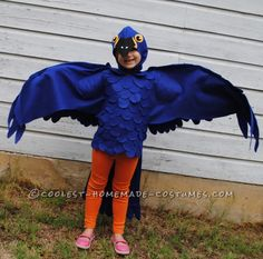 This is a blue Macaw Parrot Costume, handmade by (me) a stay at home mom and freelance artist This costume is based around a blue tshirt layered with cutou