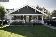gray craftsman bungalow with white trim - needs at least one more color. love the yellow door.