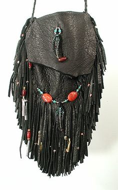 """Cynthia Whitehawk - Apache """"Raven Spirit"""" Double-Fringe Medicine Bag. Soft black deerskin with hand-carved hand-painted Bone Raven Feather totems on flap below. Turquoise, coral, red buffalo horn, nickel, copper brass beads. 5"""" x 6"""" functional size of bag; 10"""" x 12"""" with fringe extended."""