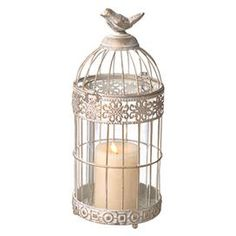 """Metal birdcage-inspired candle lantern with a weathered white and gold finish.  Product: HurricaneConstruction Material: Metal and glassColor: White and goldAccommodates: (1) Pillar candle - not includedDimensions: 14"""" H x 6"""" Diameter"""