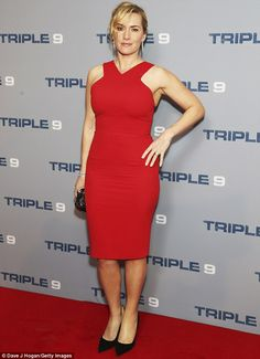 Lady in red: Kate Winslet flaunted her flare for the fashionable in a figure-hugging red n...