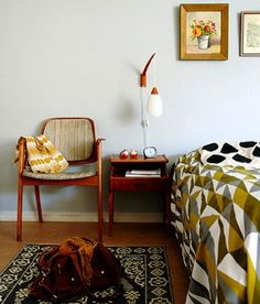 Mid century modern inspired bedroom. Bold geometrics clash with more traditional rug...in a good way!