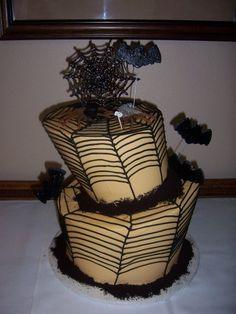 topsy turvy halloween wedding cake, complete with spider bride & groom.