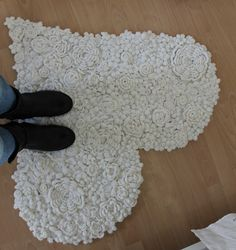 Crochet rug inspiration ~ Hundreds of white crocheted flowers stitched onto a heart-shaped template {photo tutorial}