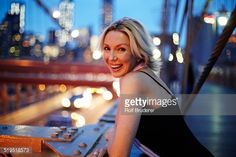Stock Photo : Caucasian woman leaning on railing on Brooklyn Bridge, New York City, New York, United States