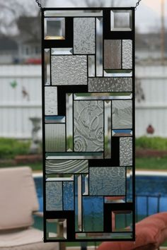 If you are looking for a truly unique gift for any occassion you should consider stained glass as that gift. Stained glass window panels are unique pieces of art that will be cherished as well as handed down from one generation to the next.   For sale is a beautiful hand-crafted geometric stained glass window panel which I call In Black and White.    This piece is truly a piece of unique art. This piece is made up entirely of Archetectural Clears, Black Glass, and 20 Stunning Bevels…