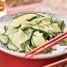 Thin strips of cucumber are seasoned with rice vinegar, red pepper, and ginger for this chilled side dish.