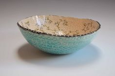Ship Date: 2-4 weeks Slab built ceramic bowl. Textured outside and glazed with a signature blue glaze. Inside decorated with the Botanical pattern and multi fired. Food safe. 8'' x 5'' About the Artis
