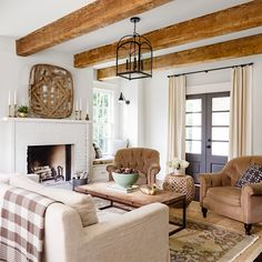 The secret to this inviting space? Top-to-bottom texture, from the scuffed beams (salvaged from an old warehouse) to the velvet armchairs to the linen draperies flanking the dark gray doors.