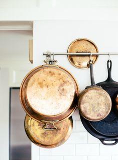 Copper pots, hanging farmhouse cookware