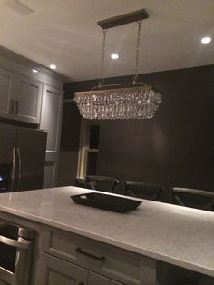The island chandelier. Pottery Barn Clarissa glass drop extra-long rectangular chandelier.