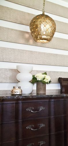 whoa, what a cool wall treatment...1x6 boards wrapped in metallic grasscloth {Beach Chic Design}