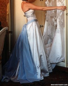 Blue Taffeta Sash    With its fitted bodice, full skirt, and chapel train, this duchesse-satin gown by Amsale could have been made for a princess. It has a touch of something blue in the form of a taffeta sash.