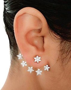 #BuyFromLink --> http://fkrt.it/Vb!7luuuuN Shining Diva Latest Bollywood Designer Cubic Zirconia Alloy Cuff #Earring #Indianfashion #Gorgeous #look #style  #Shop #Buy #online #india These ear cuffs feature elegant Bollywood-inspired floral designs and are studded with cubic zirconia stones, so they will add a touch of sparkle to your white designer georgette saree or anarkali dress.