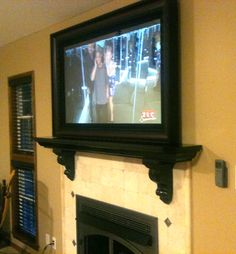 mirror tv over mantle with tv frame