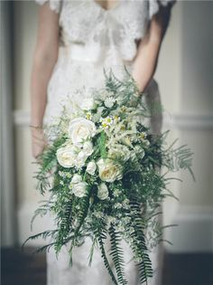 Trailing Fern Wedding Bouquet with Roses and Dasies Add ferns—which traditionally symbolize fidelity and sincerity—to your wedding bouquet for a timeless and meaningful accent. Fern Wedding, White Wedding Flowers, Bridal Flowers, Flower Bouquet Wedding, Floral Wedding, Flower Bouquets, Purple Wedding, Purple Bouquets, Wedding Blog