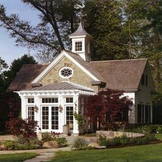 Love this--the cupola, oval window, french doors....everything