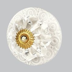 A touch of brass connects a faceted crystal ball to a white scroll engraved metal circle to create on good-looking knob. Decorative Door Knobs, Decorative Plates, Shabby Chic Knobs, Dresser Knobs, Cabinet Knobs, Crystal Knobs, Baby Furniture, Knobs And Pulls, Cottage Chic