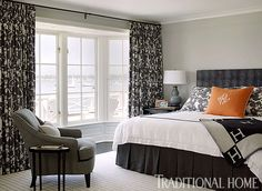 """A timeless, elegant gray—""""Pearl River"""" by Benjamin Moore—covers the walls in this stately bedroom, where rich charcoal joins gray and white to create a striking scheme."""