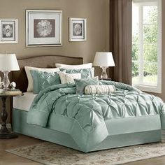 """Showcasing elegant diamond pleating and an inviting blue hue, this refined comforter set offers textural style for your guest room or master suite.  Product: Queen: 1 Comforter, 2 standard shams, 1 bed skirt and 3 decorative pillowsKing: 1 Comforter, 2 king shams, 1 bed skirt and 3 decorative pillowsCalifornia King: 1 Comforter, 2 king shams, 1 bed skirt and 3 decorative pillowsConstruction Material: PolyesterColor: BlueFeatures: Pillows include insertsDimensions: Small Pillow: 6"""" x ..."""